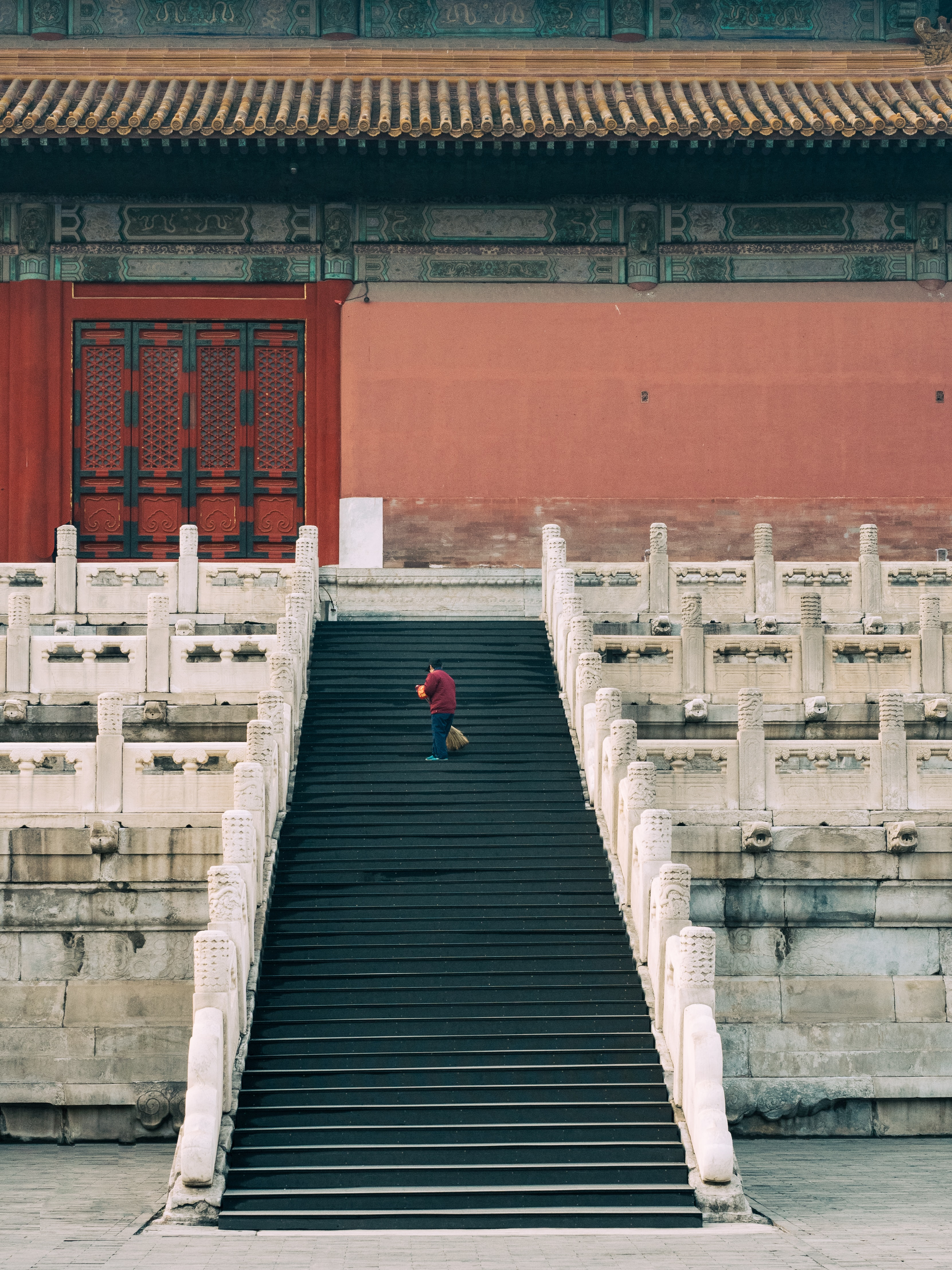 person walking on black stair