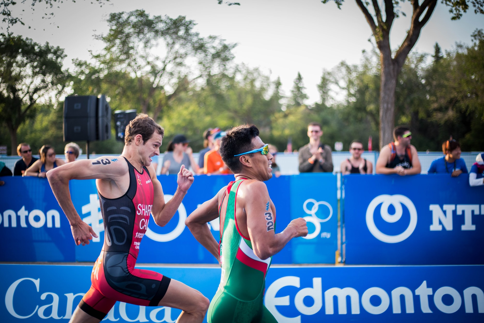 World cup triathlon, two men running, one trying to run faster than the other