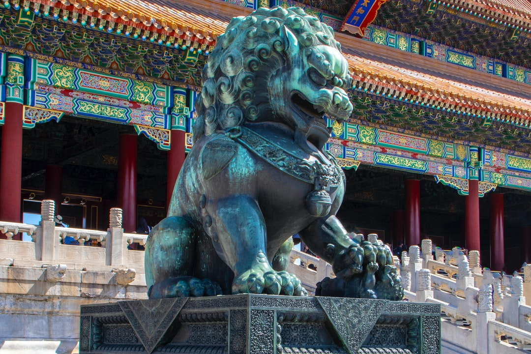 This is an Imperial Chinese Lioness in the grounds of the Forbidden Palace, Beijing, which was constructed in the 1300s.  Sometimes these are referred to as Foo Dogs and are in pairs.  This is the female or lioness, as it is playing with a cub, under it's paw.  This represents nurture.  They are often made of granite or cast in bronze.  I was lucky enough to visit the Forbidden Palace, whilst speaking at an international leadership conference, being held in Beijing.