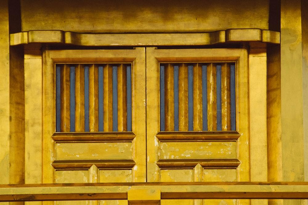 brown wooden door with grilles