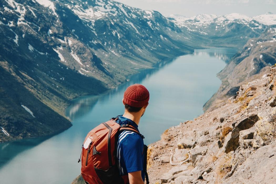 Man on mountain edge. @redhatfactory, unsplash.com