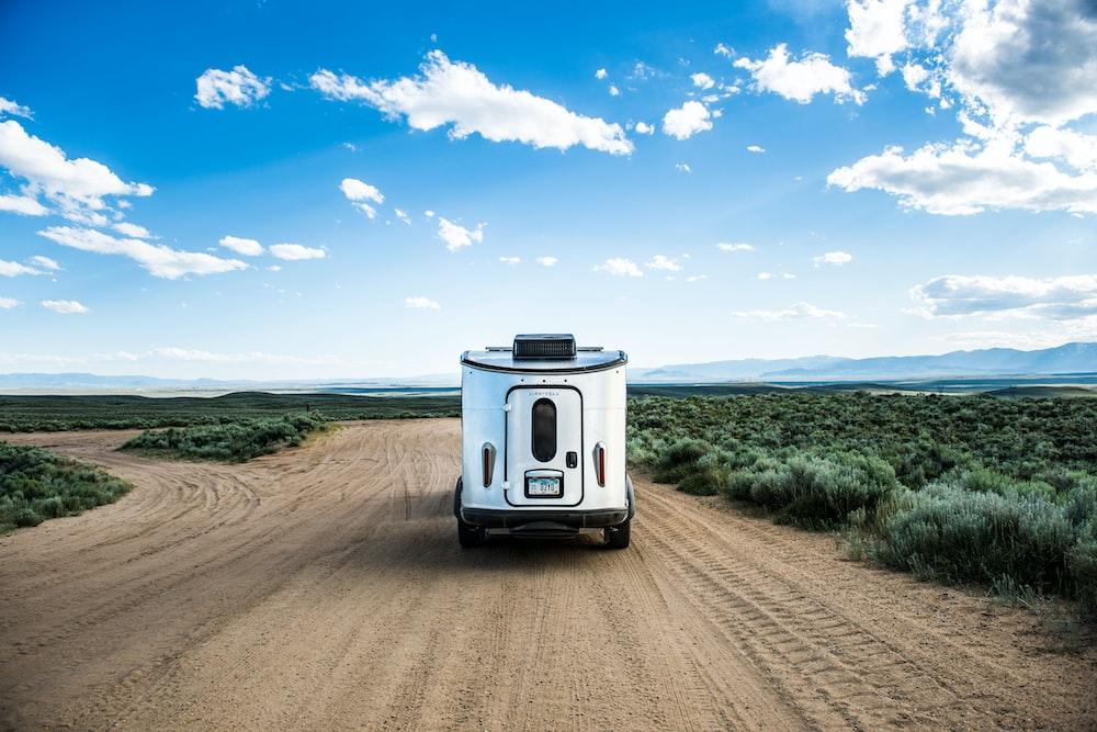 white vehicle on desert