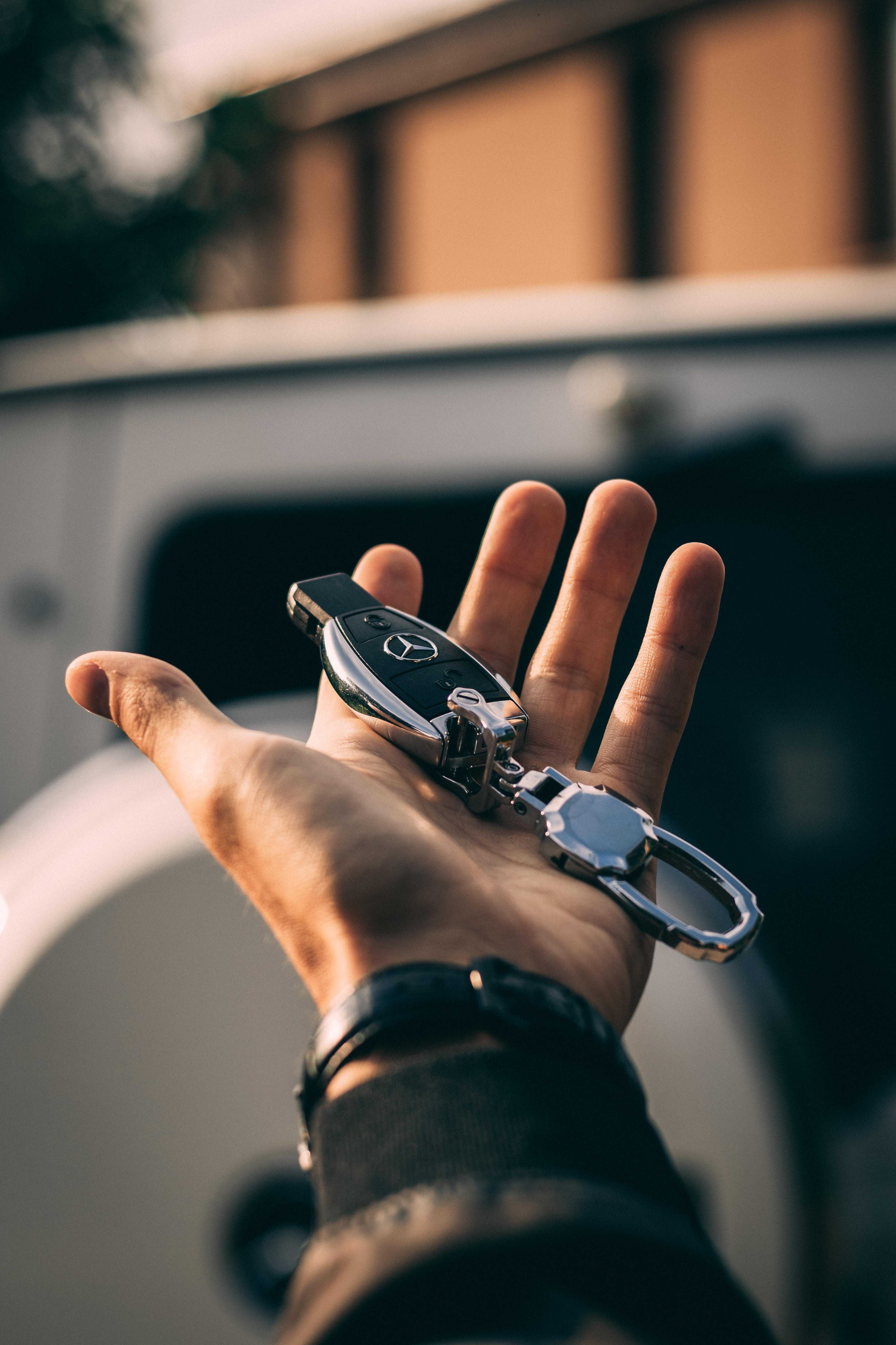 person holding Mercedes-Benz fob