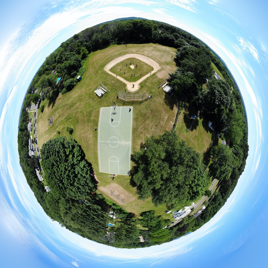 'Little Planet' style edit of a 180-degree panorama of my daughter's little league game this summer. Shot with DJI Mavic Air from about 150 feet up.