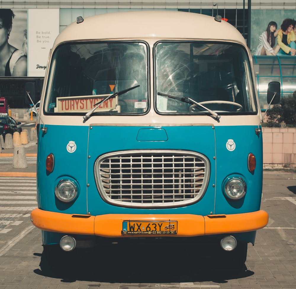 blue classic van parked on parking lot during day