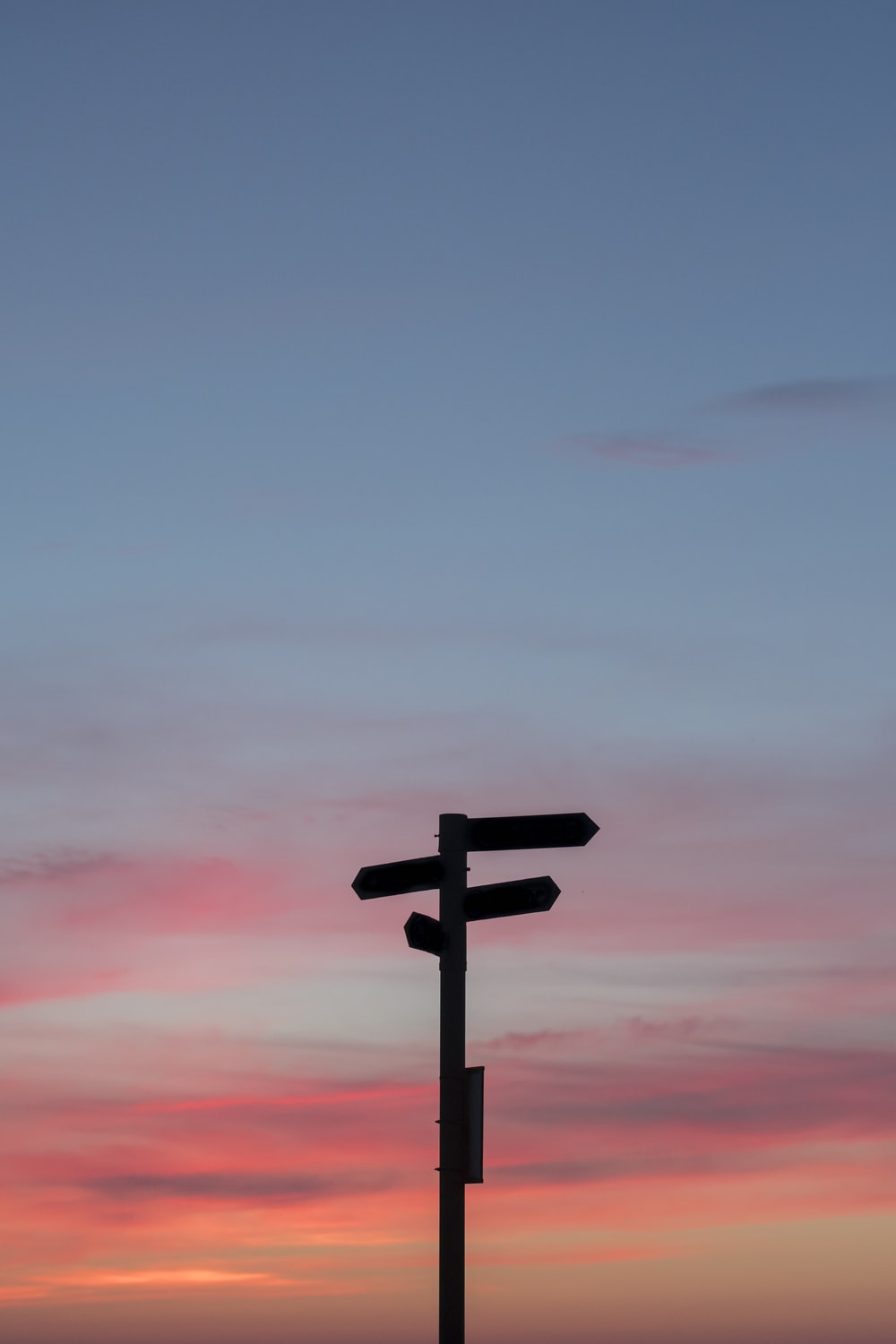 silhouette of a road signage during golden hour