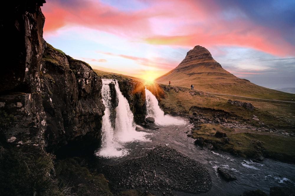 waterfalls between rock formation at golden hour
