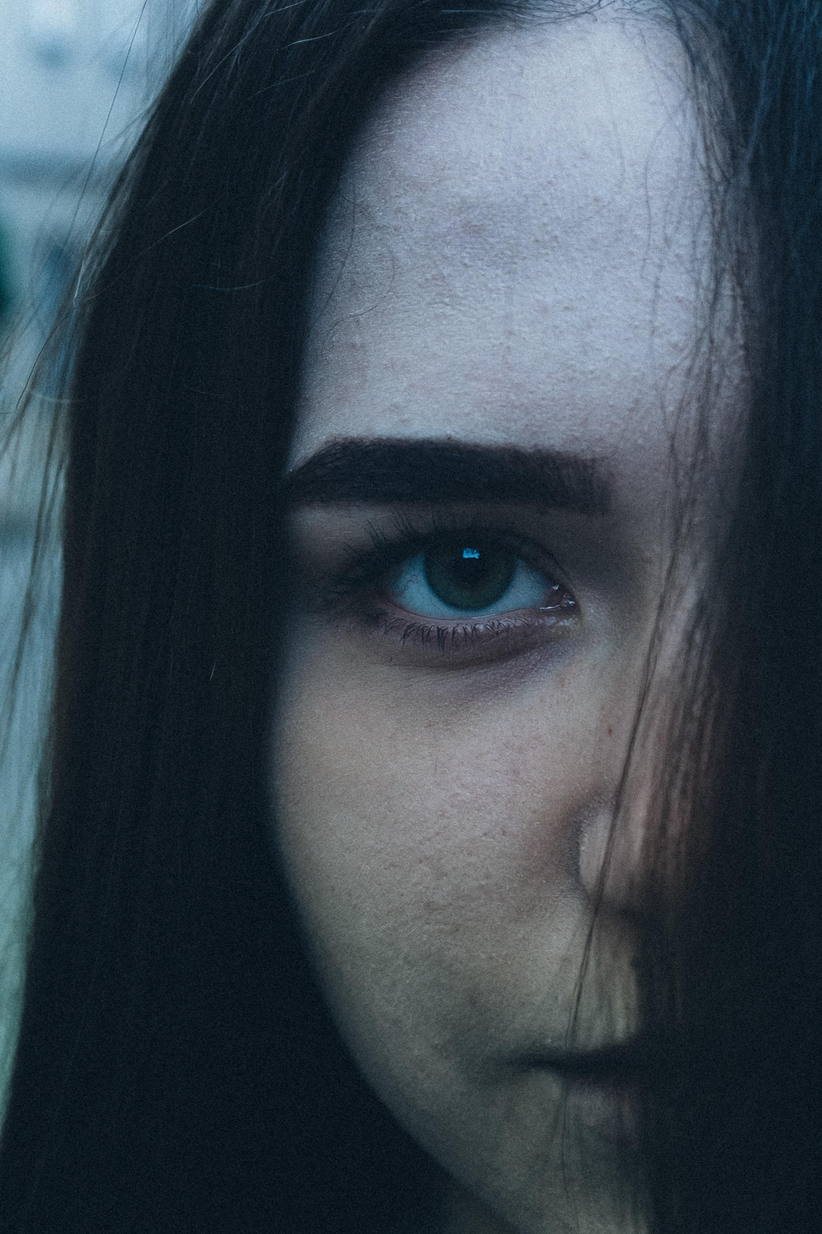 closeup photo of half face of woman