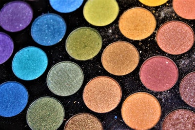 macro photograph of eyeshadow palette sparkle teams background