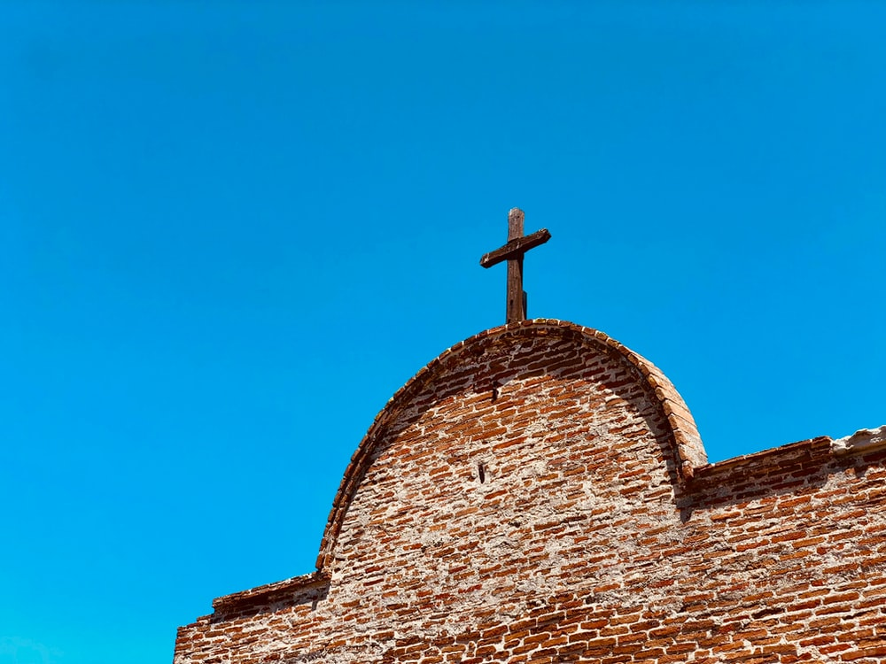 brown cross on chapel