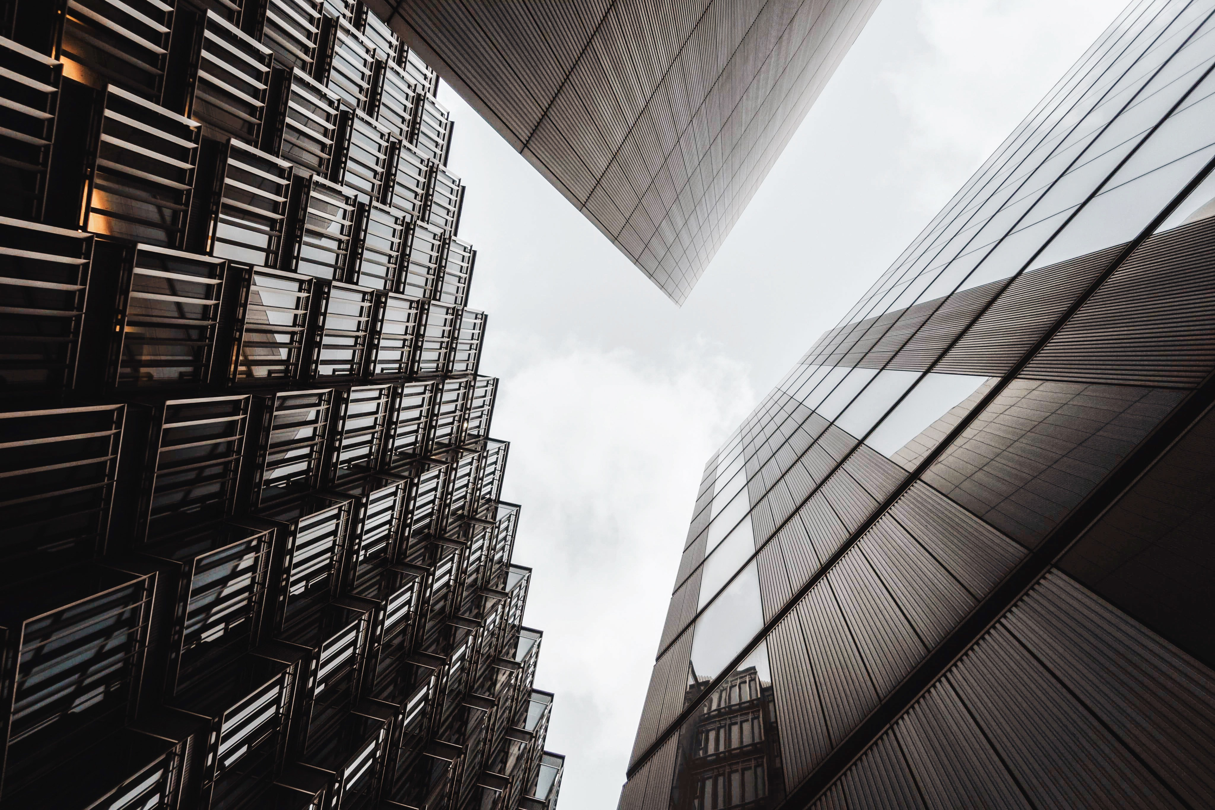 low angle of three gray high rise buildings