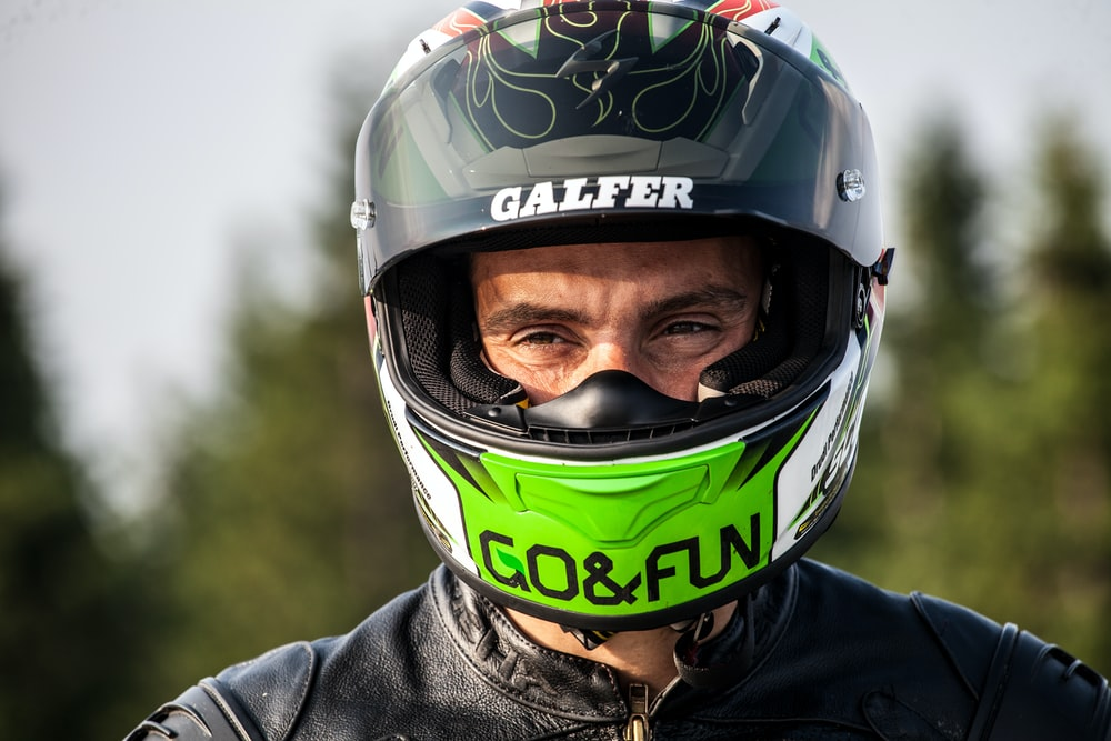 man wearing black multicolored helmet