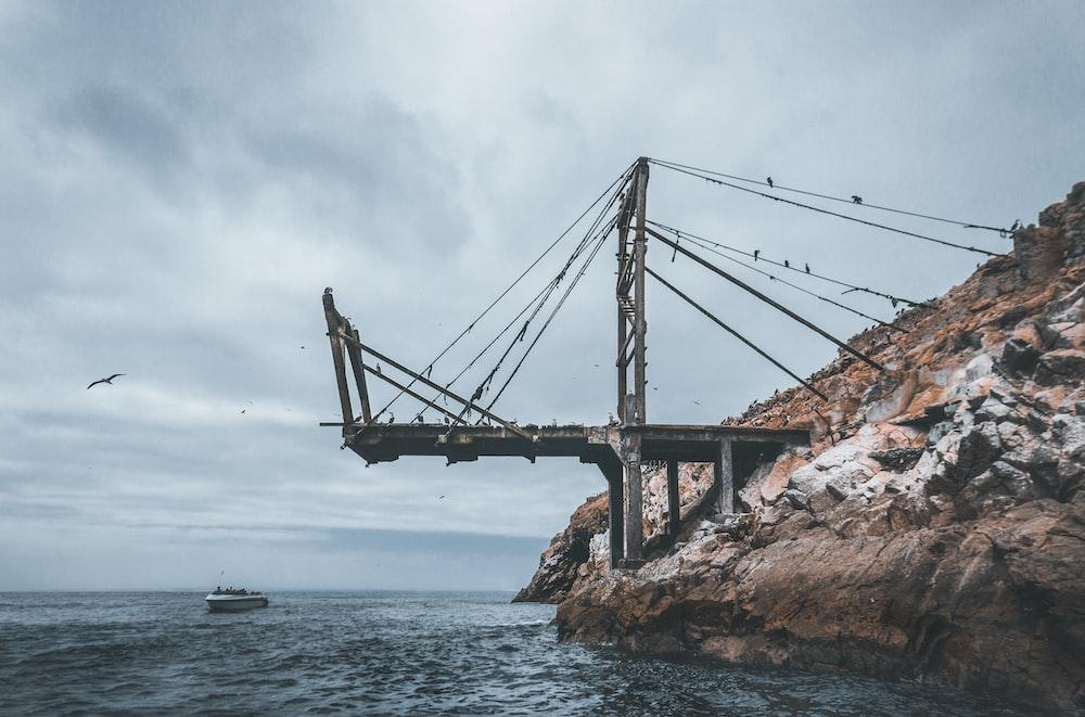 metal bridge near boat during daytime