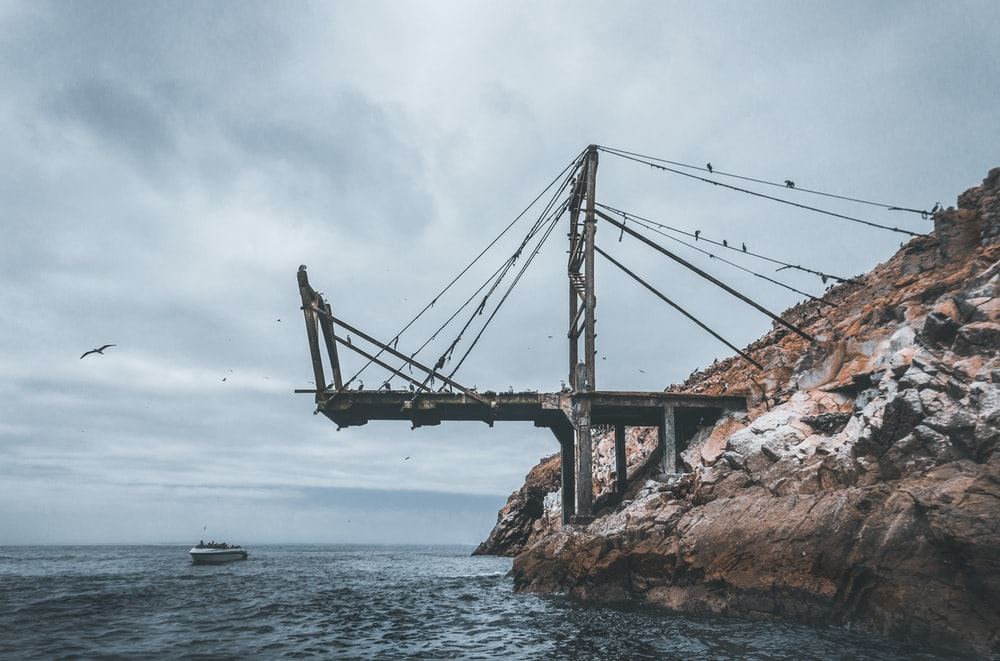 metal bridge near boat during daytime