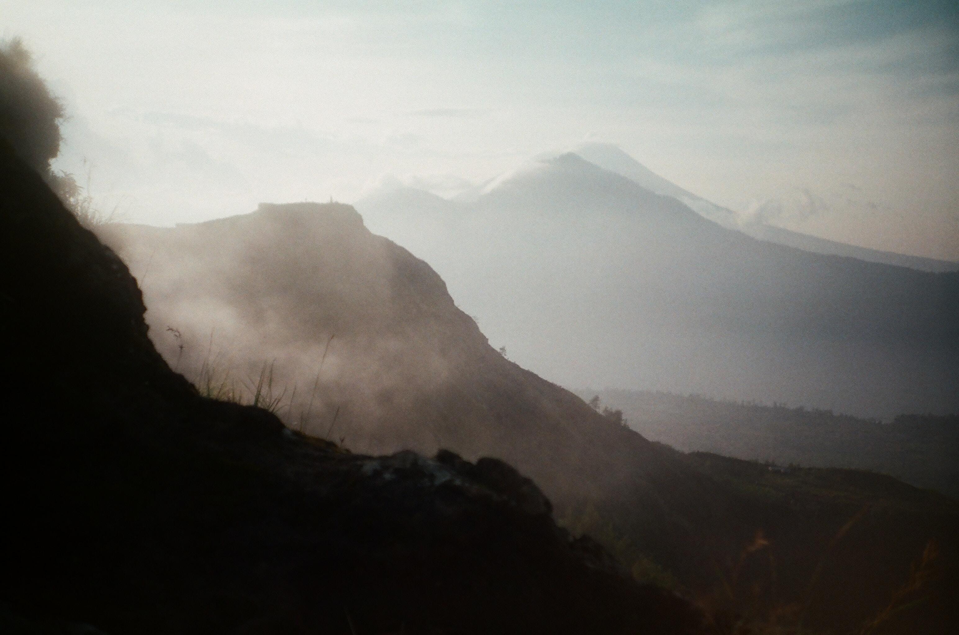 brown foggy mountain during daytime