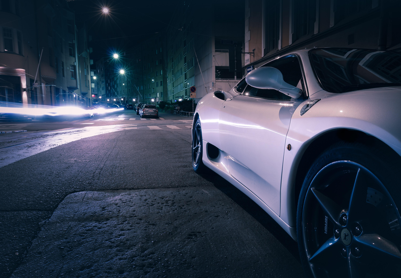 white car running during night time
