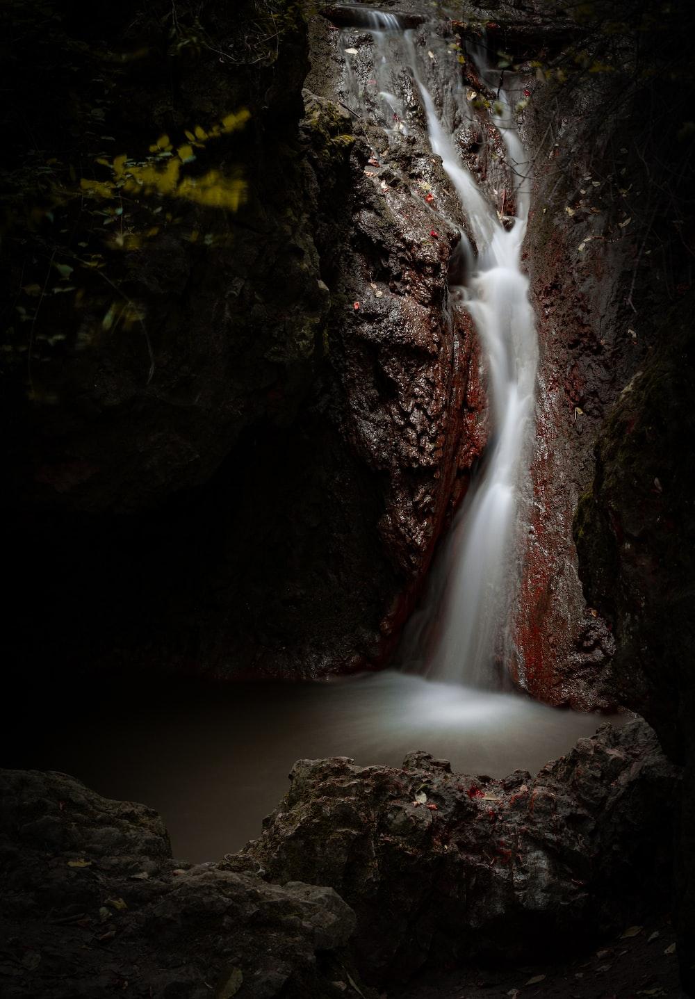 waterfalls between rock formation