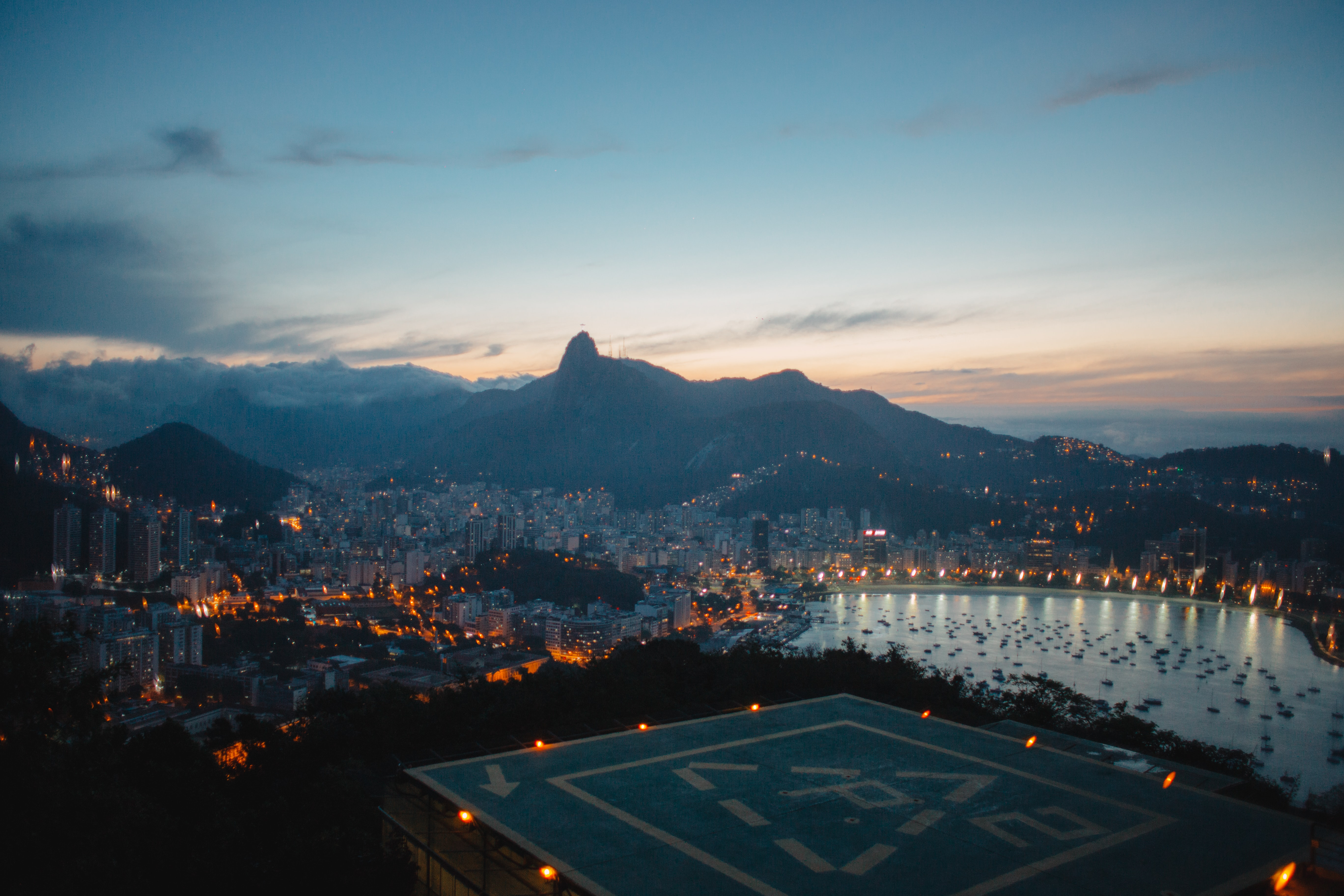 aerial photography of buildings and mountains at blue hour