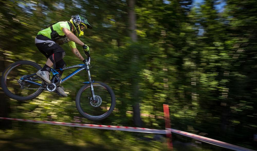 man riding blue bike