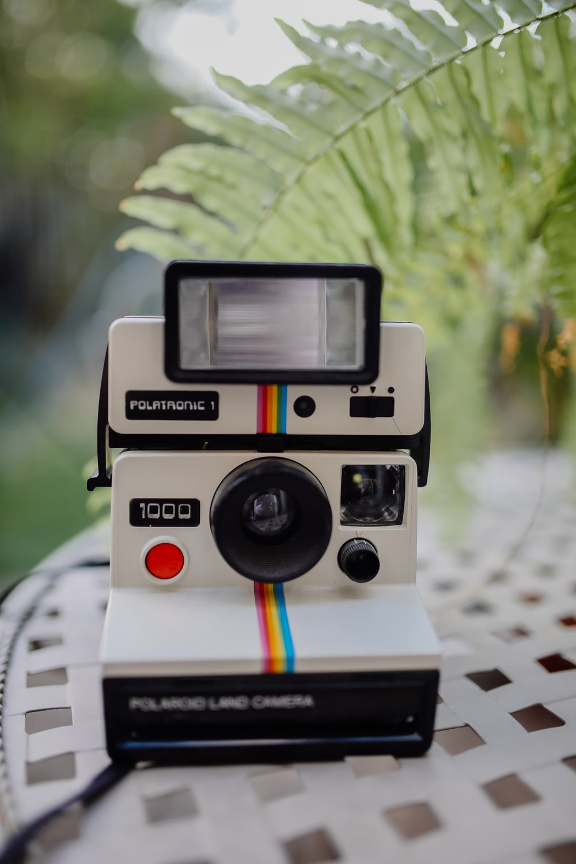 white and black Polaroid land camera