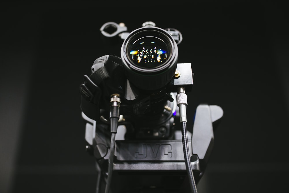 black JVC camera on top of surface