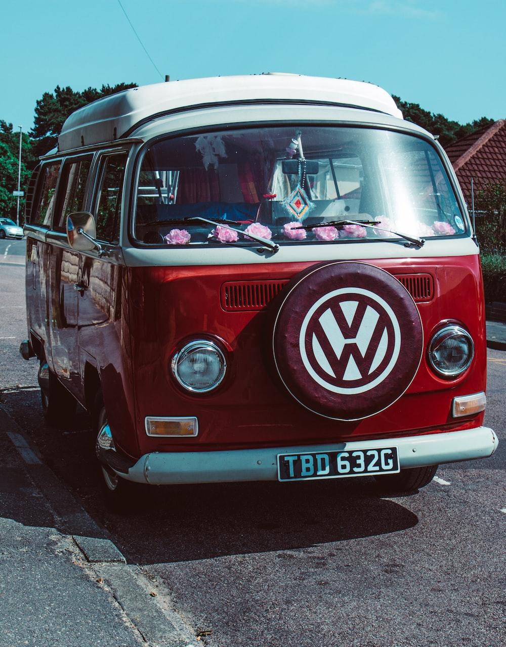 red Volkswagen T2 van parked near house