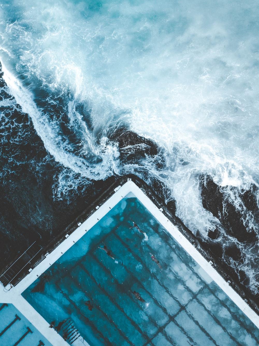 Aerial View Of Ocean Beside Dock