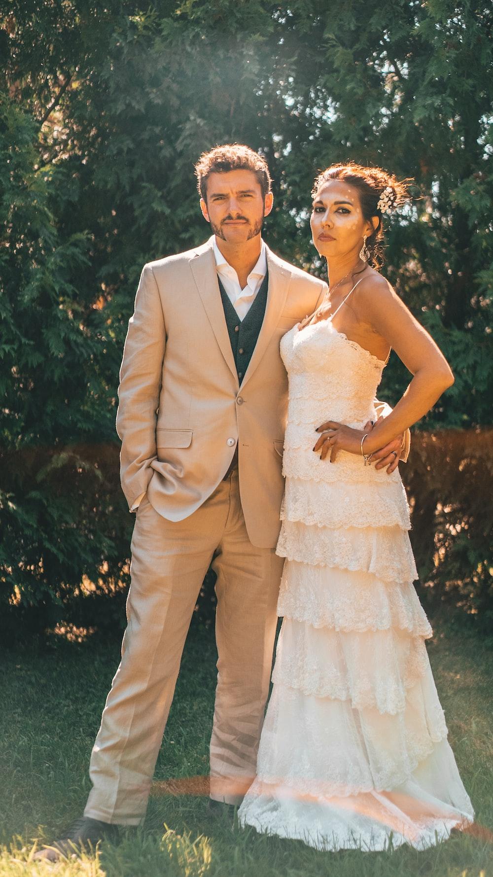 woman in white dress beside man