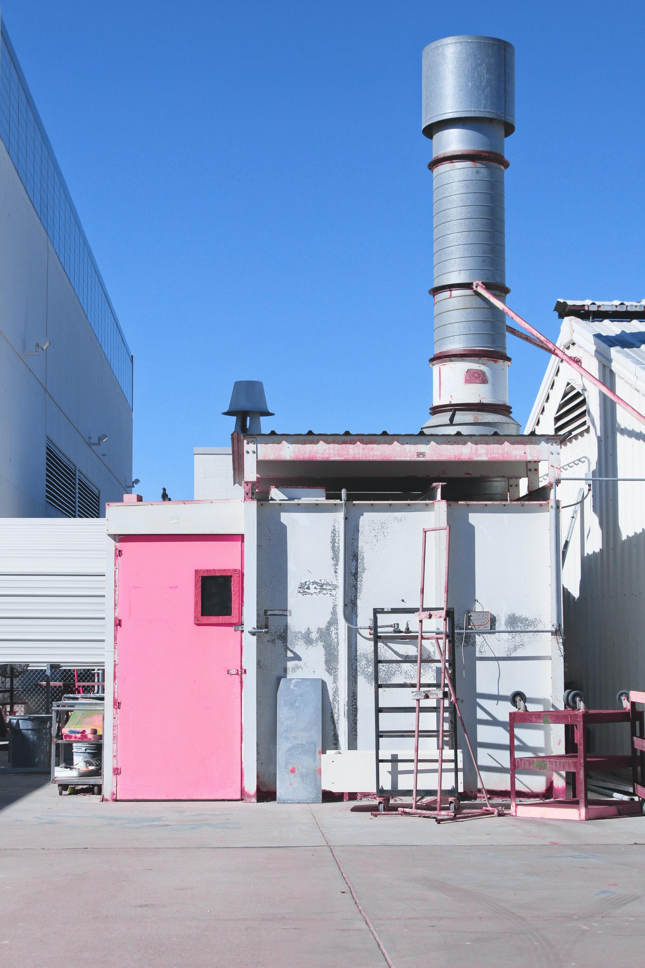 gray metal shed with pink door