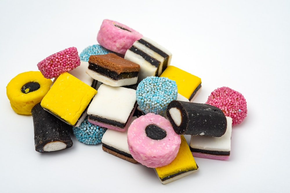 pile of sweets on white surface