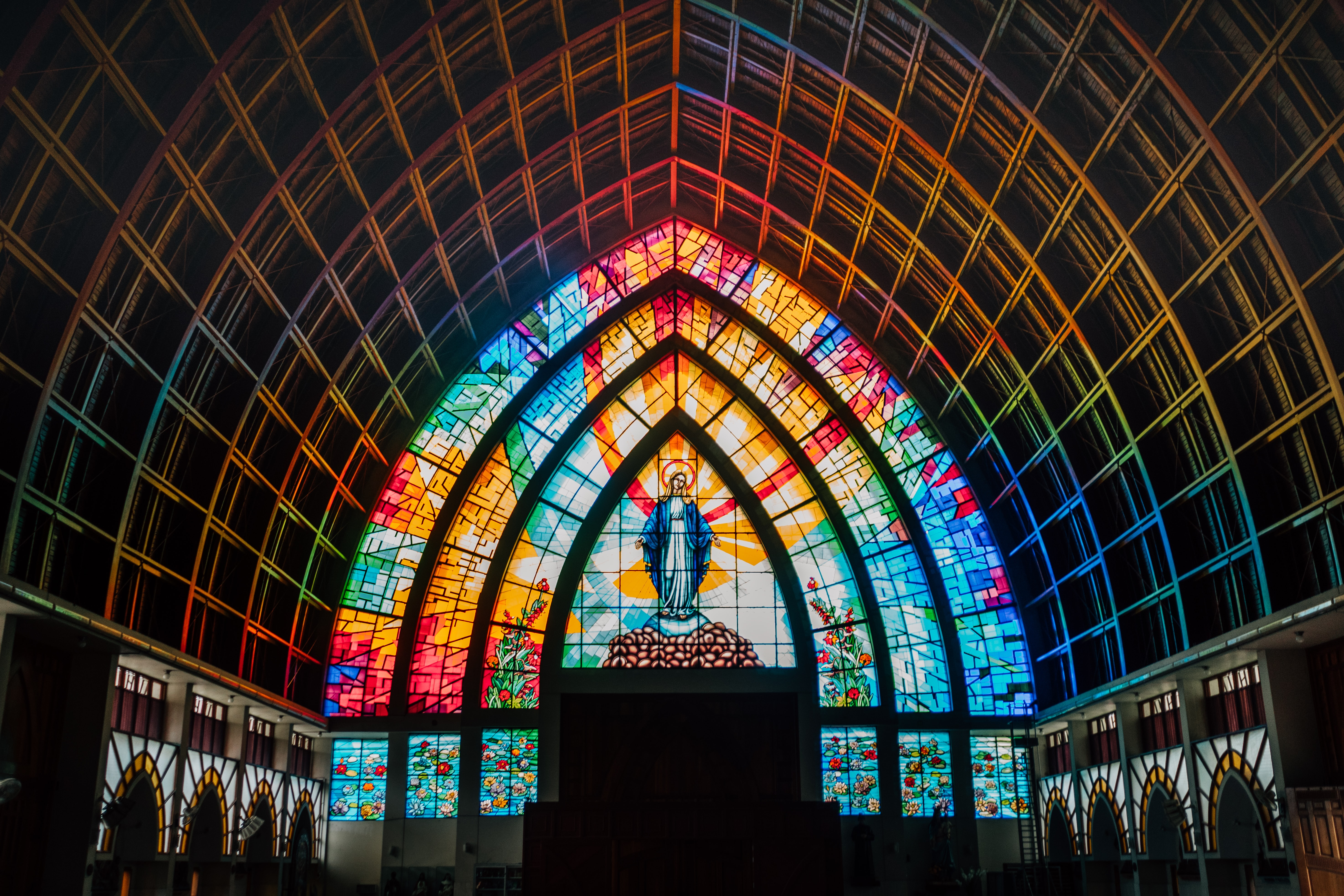 Mother Mary mosaic glass window cathedral interior