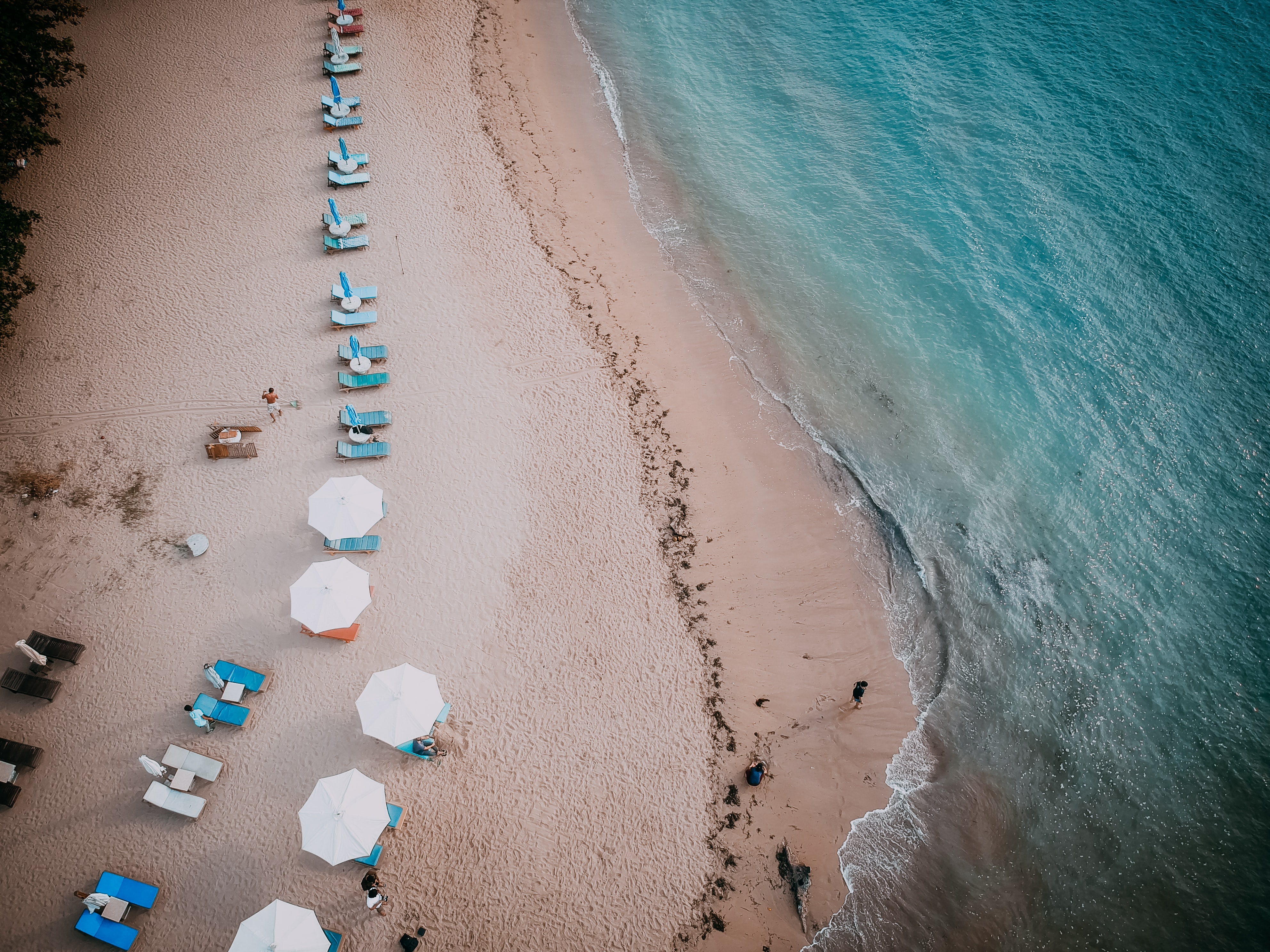 aerial photography of beach lounger on seashore