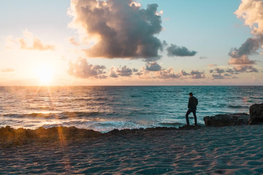 silhouette of man on seashore