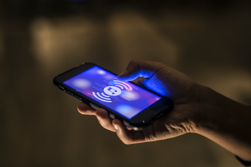 person holding black smartphone playing music