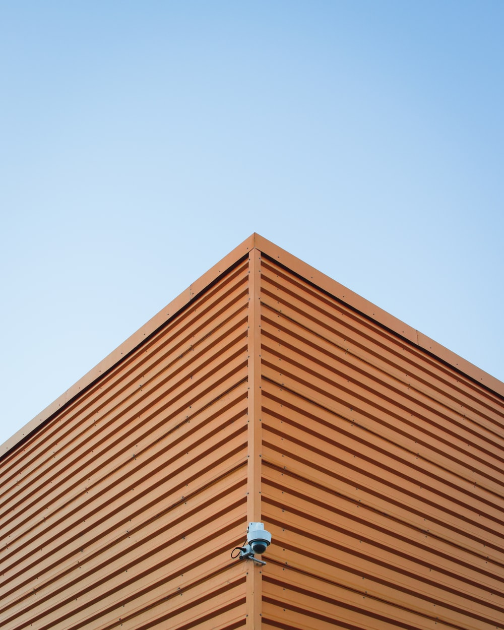 brown roof with surveillance camera attached