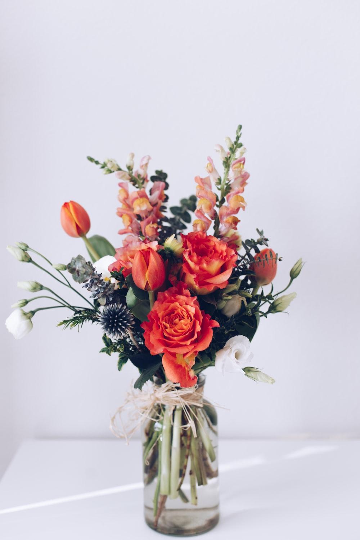 red flower arrangement on white table