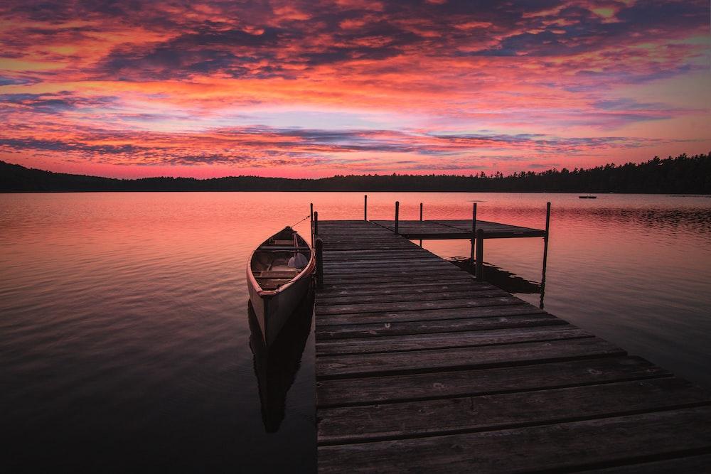 dock bridge beside canoe
