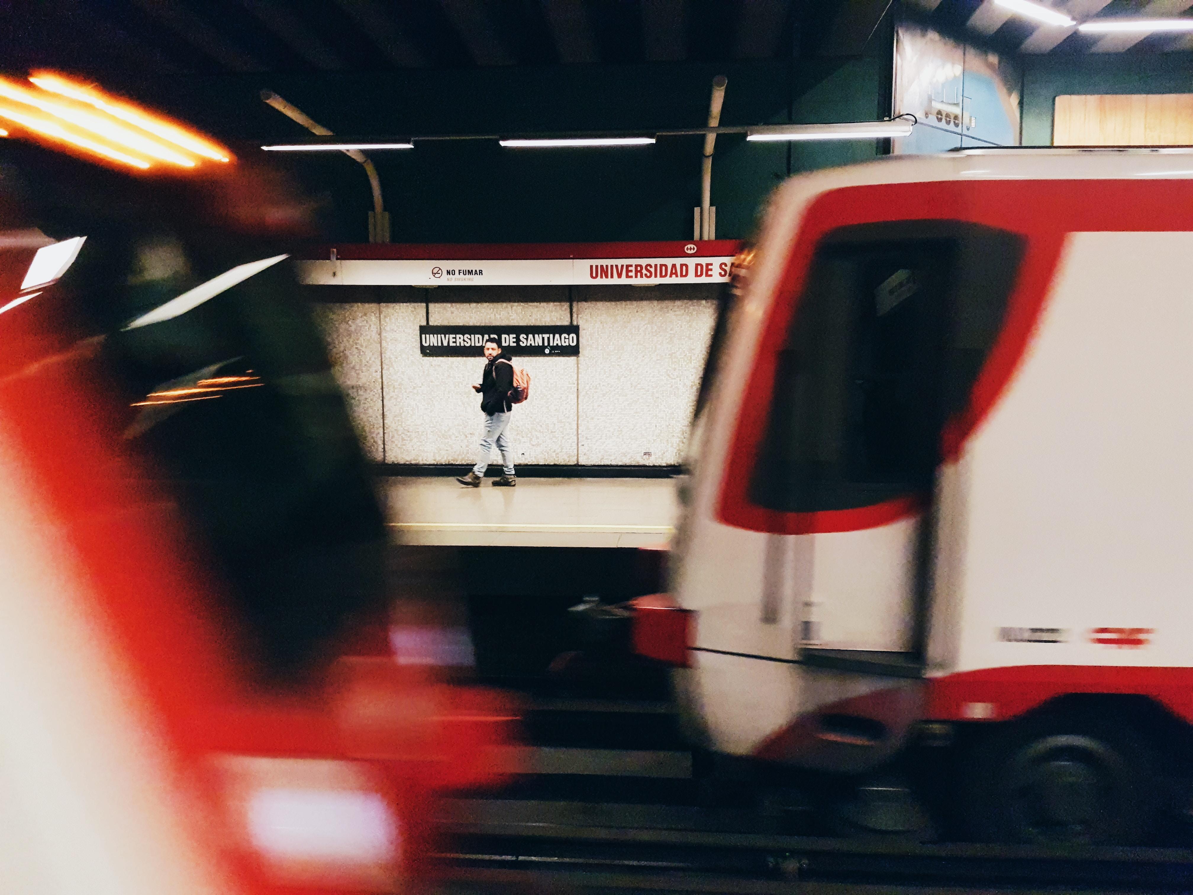 man walking near train