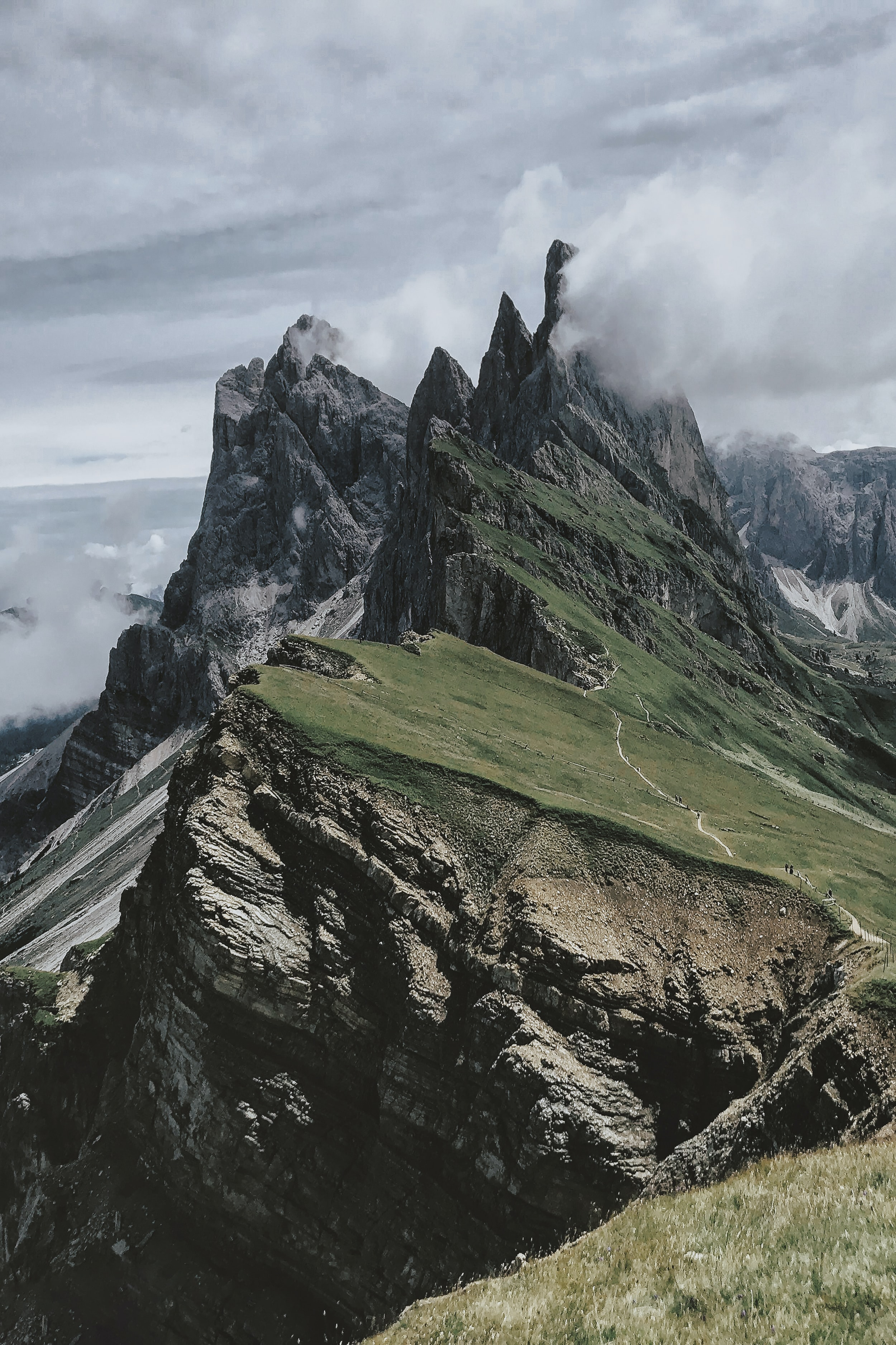 green and gray rock mountains under white cloud