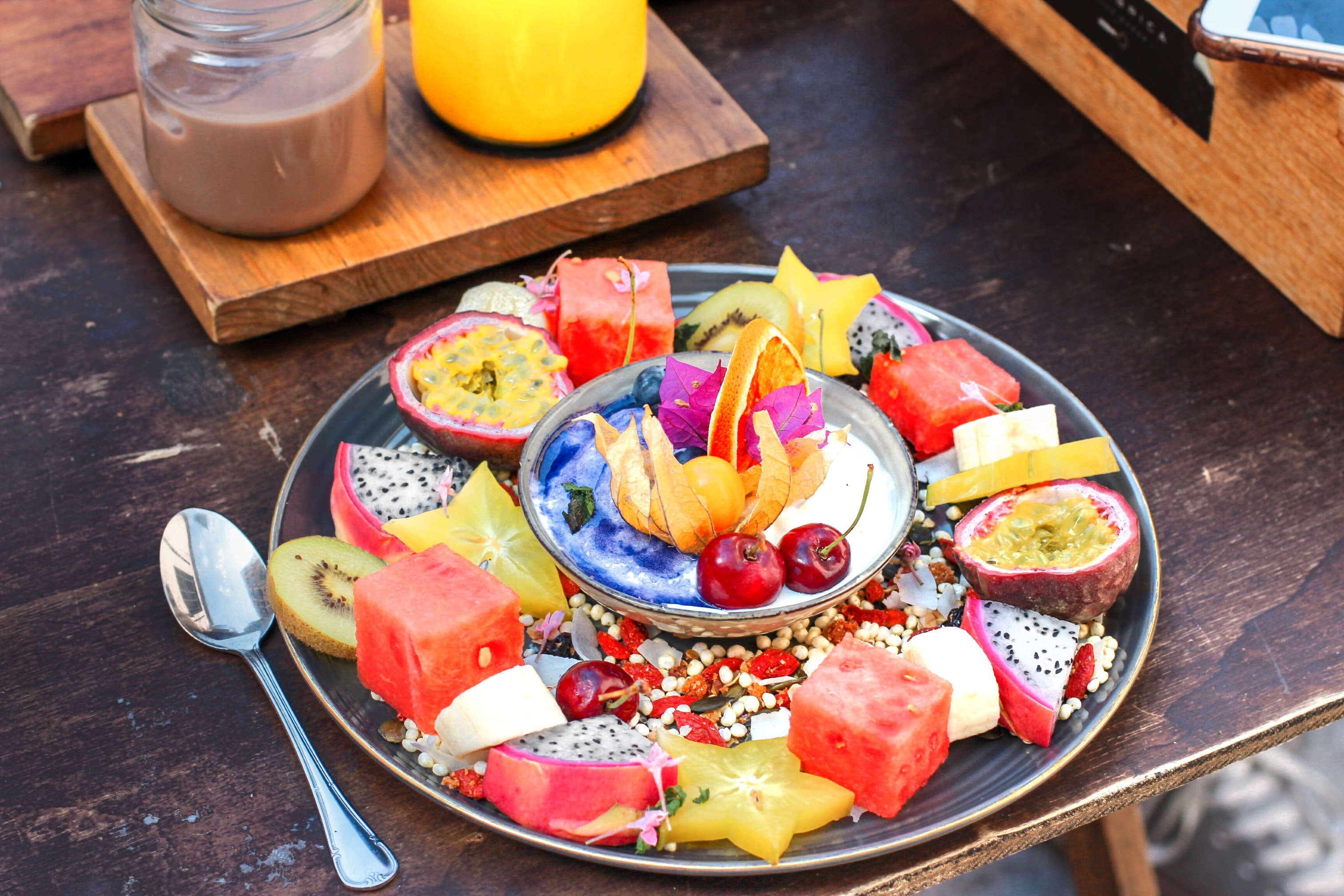 slice of fruits on plate with spoon