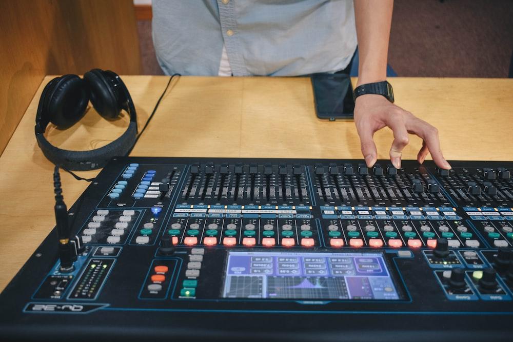 person using audio mixer