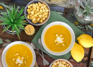 flat lay photography of popcorn on porridge with lemon fruits