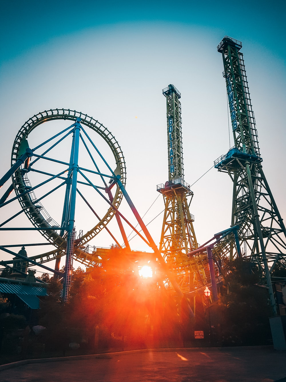 roller coaster ride with sun rays