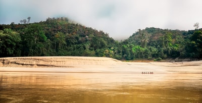 dried up lake near mountains laos teams background
