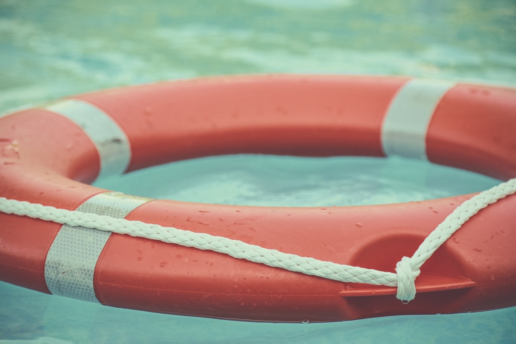 red and white lifebuoy