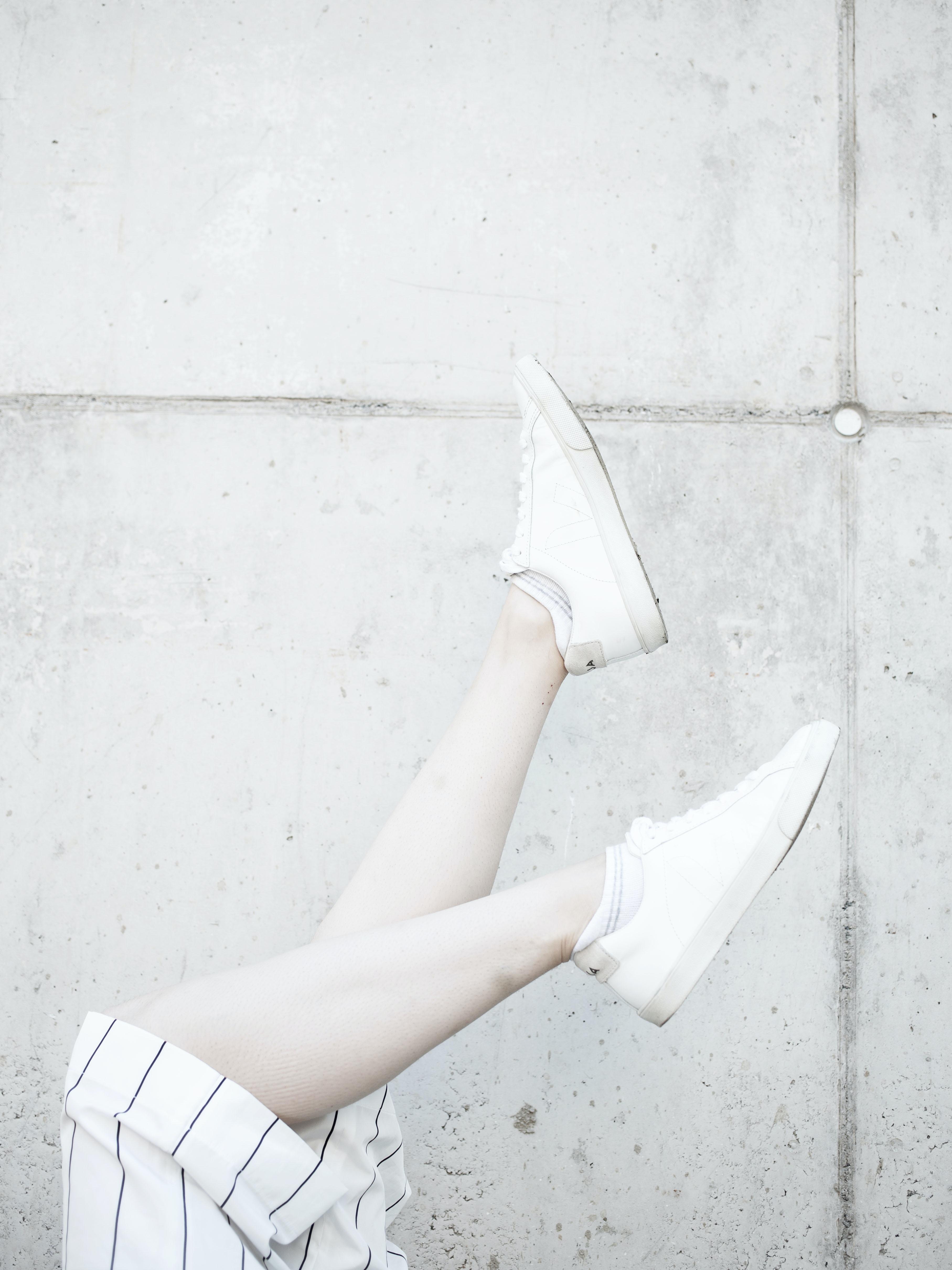 person raising its foots near wall