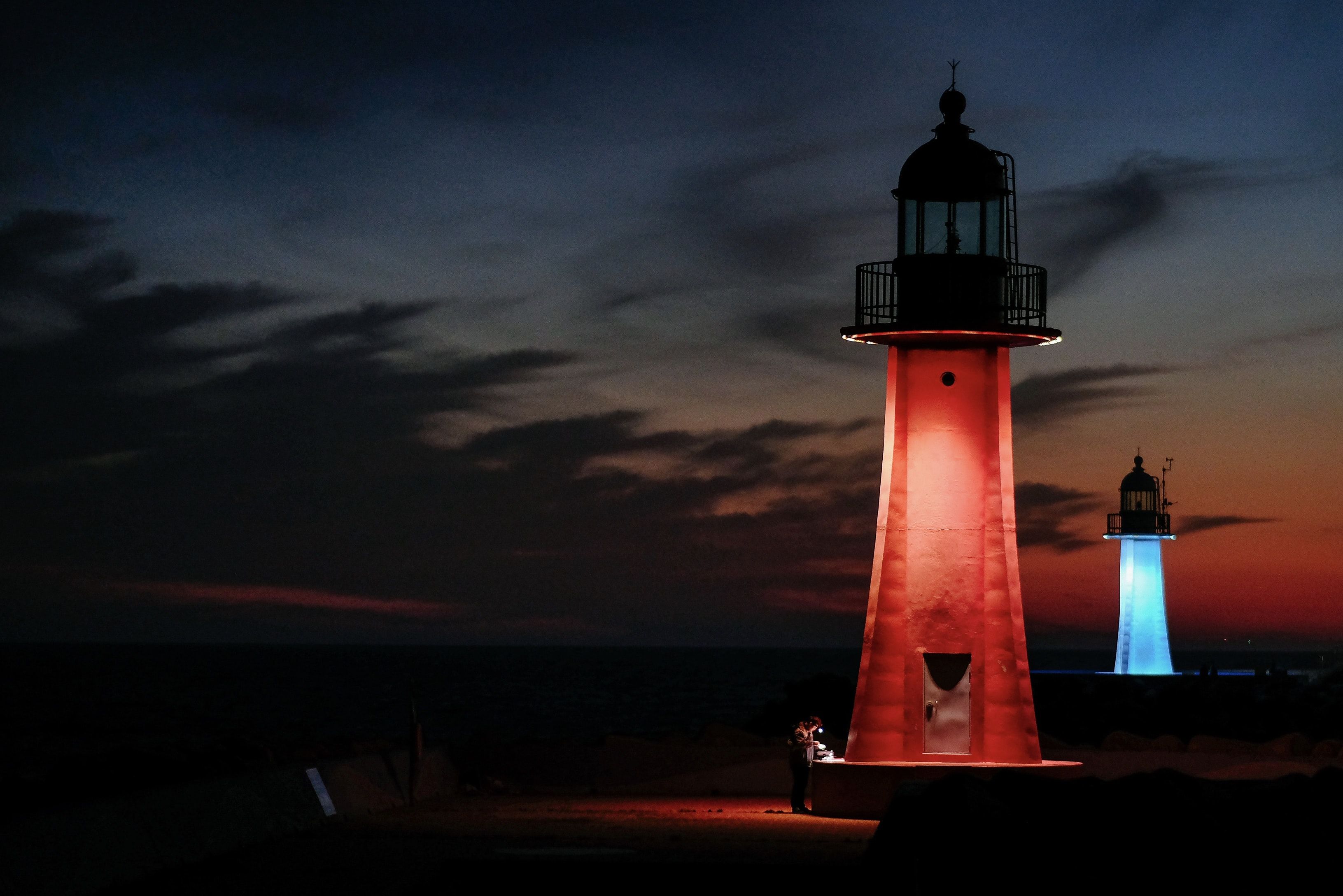 red and blue lighter watch towers during nighttime