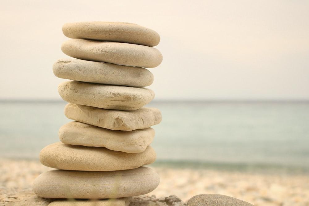 stack white stones on seashore