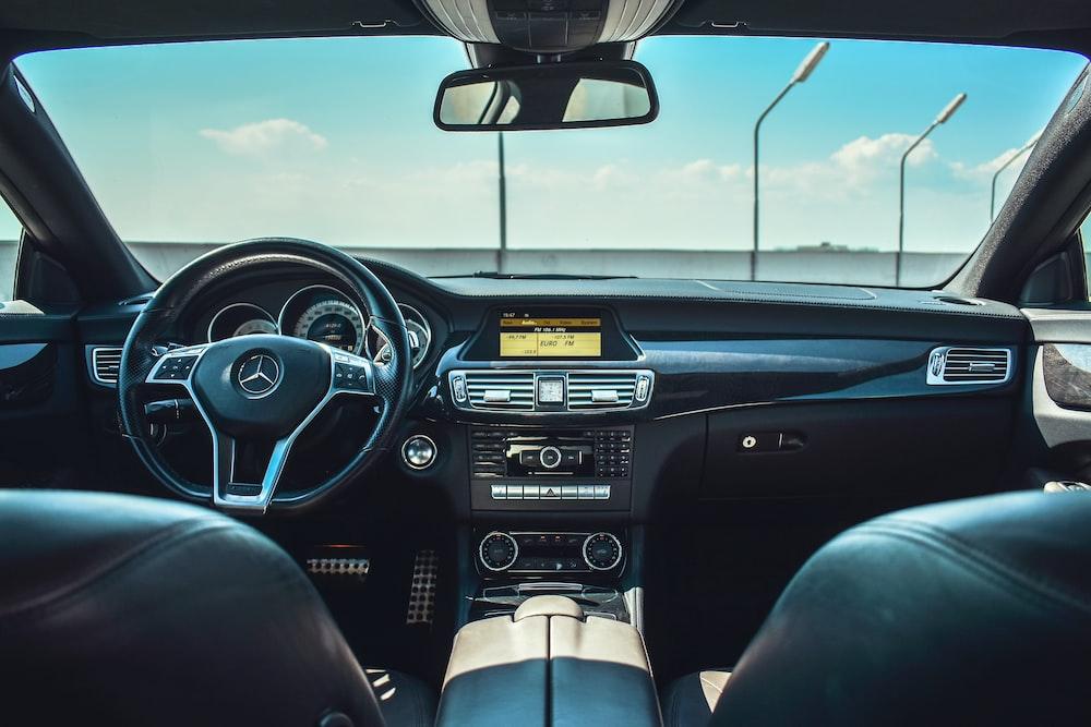 black Mercedes-Benz vehicle steering wheel