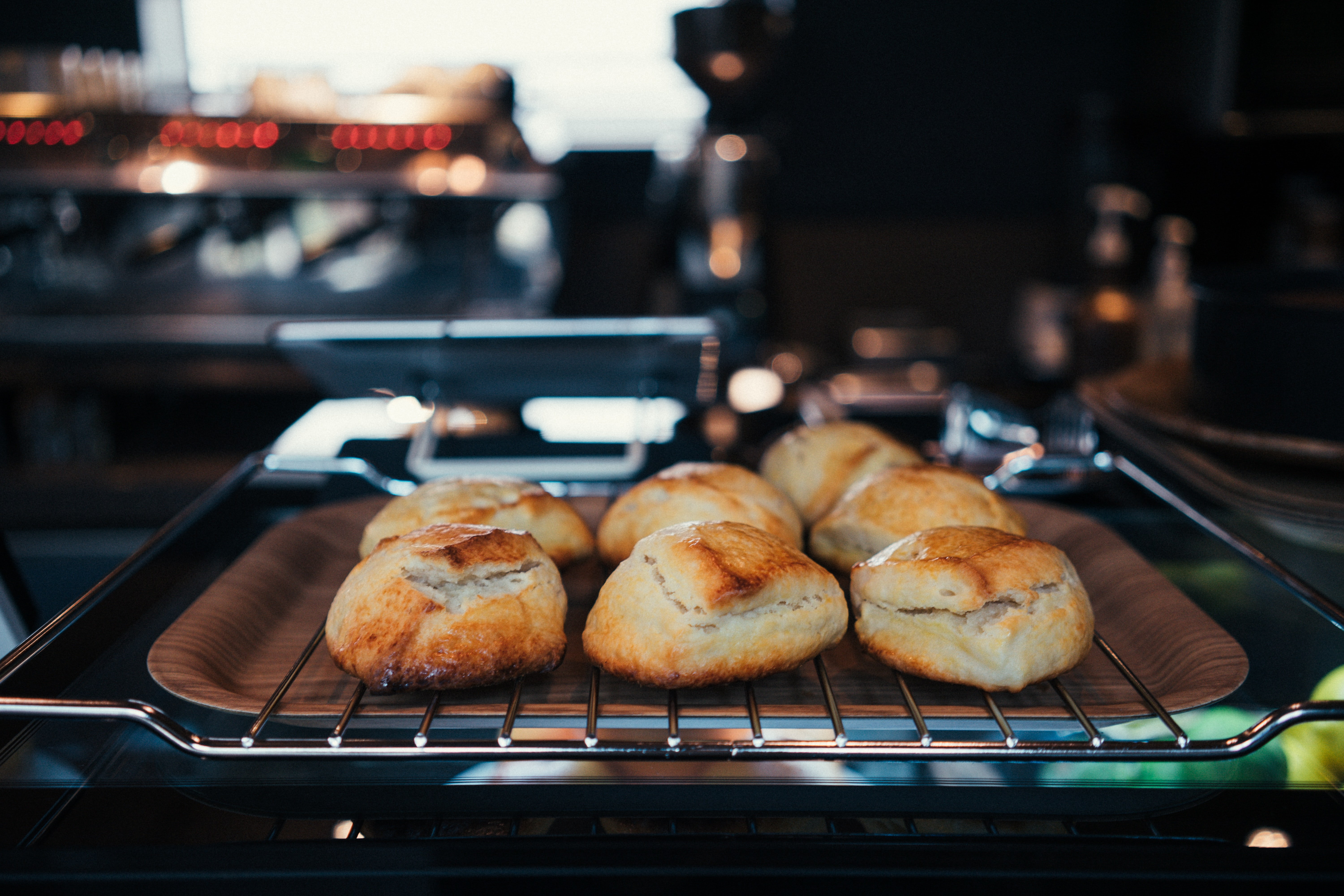 seven buns on gray steel grill